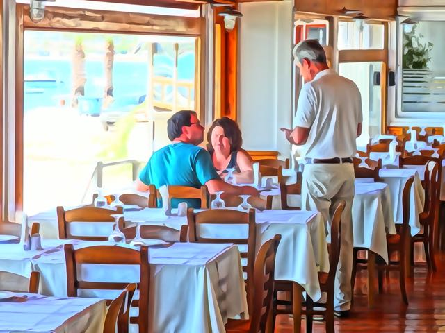 Greek food what to expect in a greek restaurant for Fish in a bottle menu